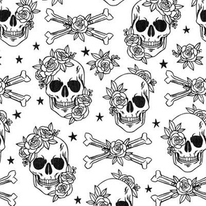 black and white skulls with flowers