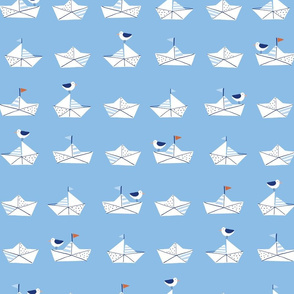 Paper boats in blue
