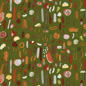 Charcuterie platter on dark moss