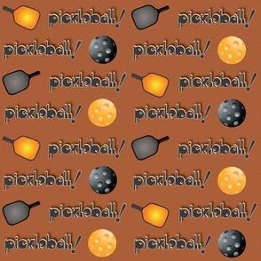 Pickleball Row  Orange & Black on Brown