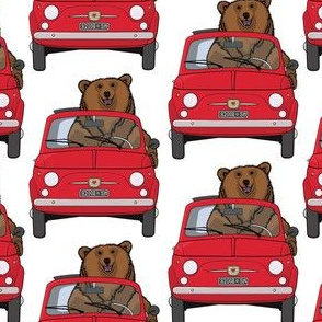 A smiling bear in a red car