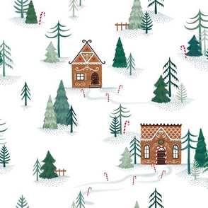Gingerbread houses in snowy forest
