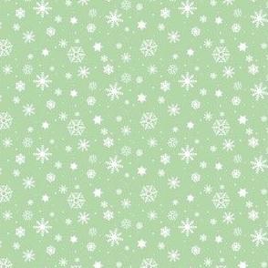 snowflake repeat on light green