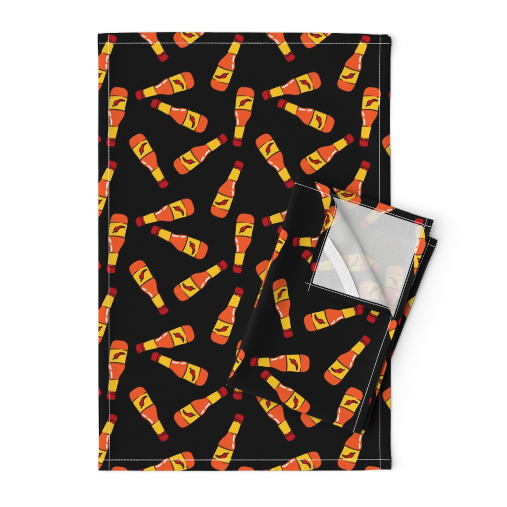 Orpington Tea Towels featuring hot sauce bottle - toss on black - LAD19 by littlearrowdesign