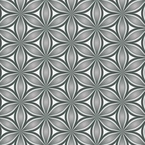 Geometric, repeating floral shapes.