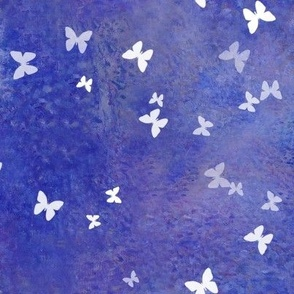 Small white butterflies on puple and blue