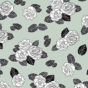 White roses on green background