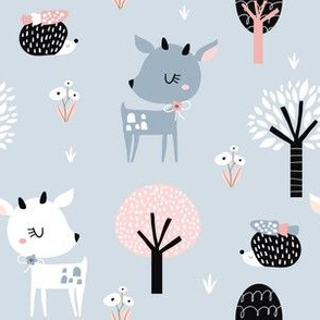 Adorable deers in the forest