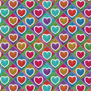 Cute knitted hearts pattern on pink/purple background