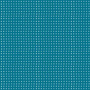 White dots on mosaic blue