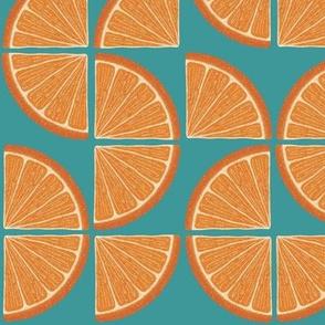 Freshly squeezed- orange slices on turquoise