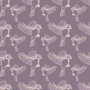 Birds flying on purple sky