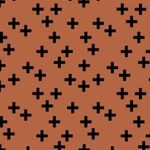 Geometric plus Scandinavian abstract sign design little cross copper rust brown