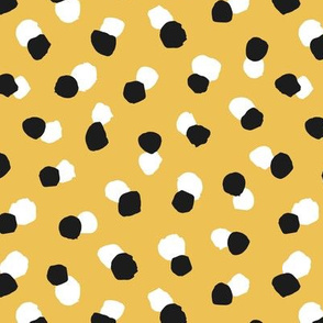 Abstract spots and dots abstract animal print trend design black and white ochre yellow