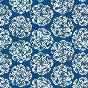 White Medallion Flowers on Classic Blue