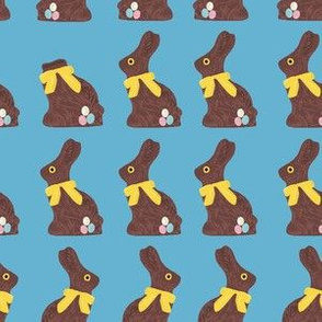 Chocolate easter bunny blue background
