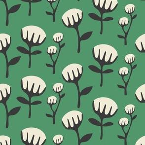 White flower, black stems, green background