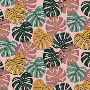 Tropical monsteras on blush pink