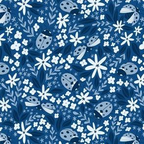 Ladybugs on blue background