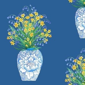 Vintage vase, chinese jar with daffodils and blue bells on classic blue