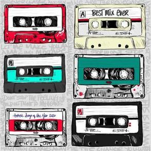 Retro cassette tapes on gray