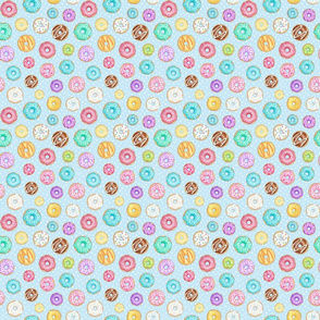 Rainbow Scattered Donuts on spotty pale blue - small scale