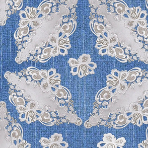 Small repeat lace patterns on blue denim