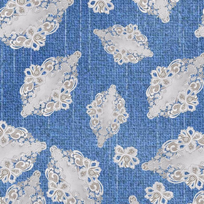 white lace twisted repeat design on blue denim