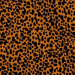 animal print - burnt orange + black