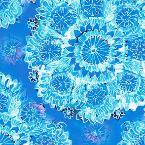 White lace snowflakes on a blue background