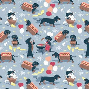 Tiny scale // Hot dogs and lemonade // pastel blue background Dachshund sausage dogs