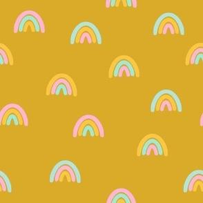 pastel rainbow on mustard