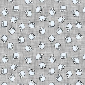 Toilet paper rolls on linen texture