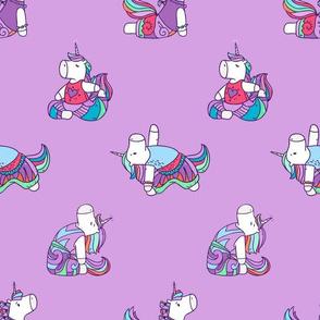 Yoga Unicorns on purple background