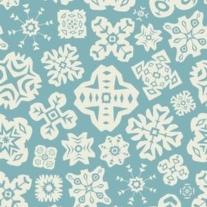 Cut Paper Snowflakes in White and Pale Blue from UnBlink Studio by Jackie Tahara