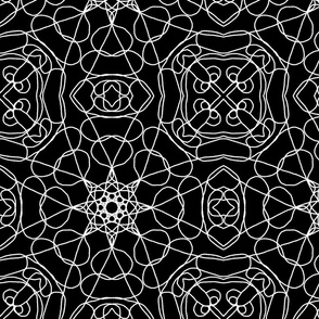 Ornamental tile design white on black