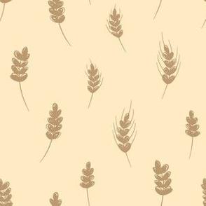 Wheat ears on yellow