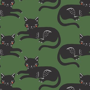 lounging cats // black cats on green