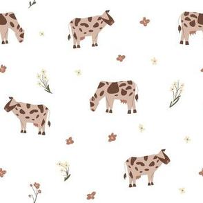 Cows on a flower field