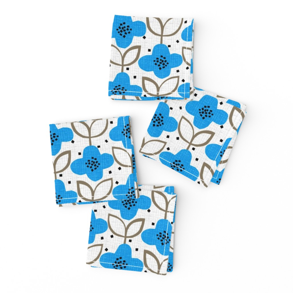 Frizzle Cocktail Napkins featuring blue cut-paper flowers-spring by ottomanbrim