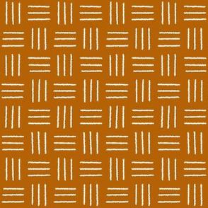 mudcloth basket weave white on burnt orange