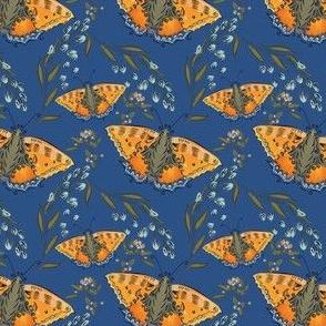 orange butterflies on blue