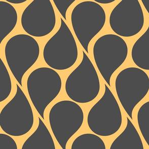 Black paisley drops on golden beige background