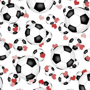 soccer balls sports pattern with pink and red hearts