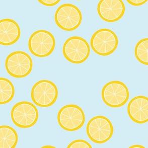 Little slices of lemon bright yellow fruit cocktail summer design on blue