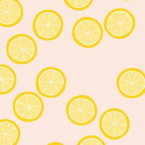 Little slices of lemon bright yellow fruit cocktail summer design on pale pink