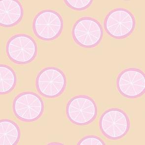 Little slices of lemon bright pink fruit cocktail summer design on sand