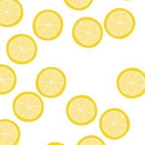 Little slices of lemon bright yellow fruit cocktail summer design on white