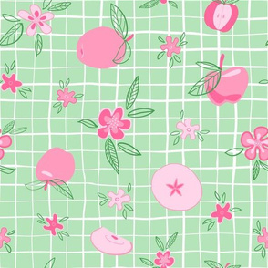 Pink apples and flowers on green and white plaid background