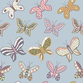 Garden butterflies fluttering on a sky blue background